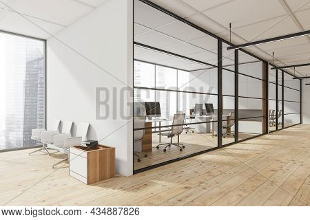 Office Corridor With A White Seating, Wood Plank Flooring, Linear Lights, A Frame Glass Partition Wa