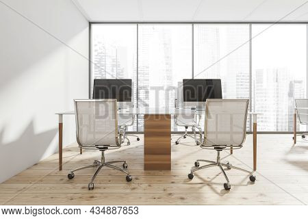 Panoramic White Interior With A Combined Office Desk With Mesh Office Chairs And A Wood Plank Floor.
