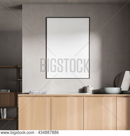 View Of An Empty Framed Poster On The Grey Wall Over A Sideboard In The Living Room Area With A Shel