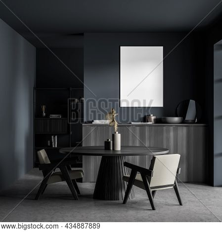 Poster In The Dark Blue And Grey Living Space With A Round Table, Two Easy Armchairs, A Sideboard An