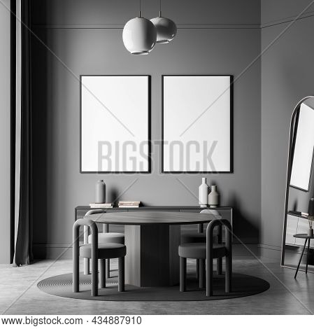 Two Canvases On Wall Of Grey Living Space Interior With Round Table, Creative Stools, Two Pendant La