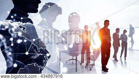 Group Of Business People Work Together Talking And Discussing Working Process In Company. Office Wor