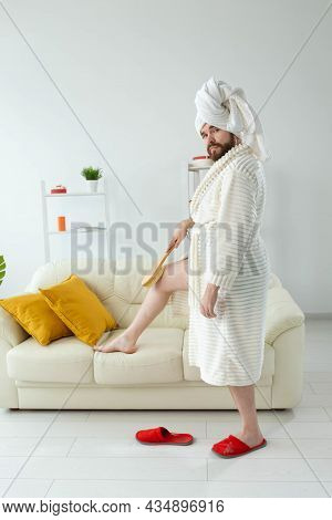 Portrait Of Cheerful Guy Wear Turban Towel Makes Himself A Massage With Massage Brush. Male Skin Car