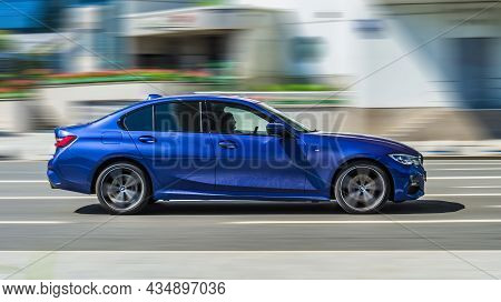 Bmw 330e M Sport G20 Moving Fast On The Street Of Moscow. Bmw 3 Series Car Rushes On The Road With B