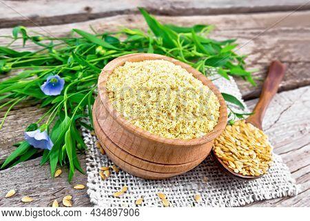 Bran Flaxseed In Bowl On Old Board