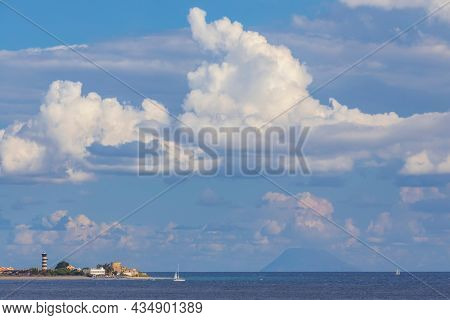 Capo Peloro Lighthouse in Punta del Faro on the Strait of Messina, most north eastern promontory of Sicily, Italy
