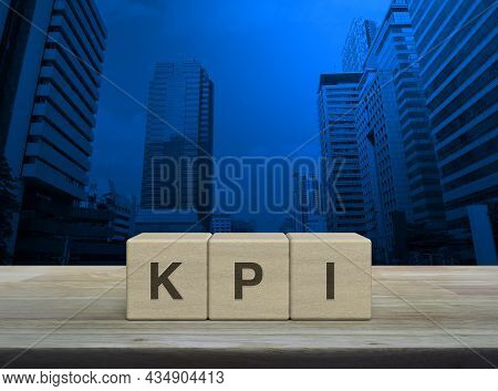 Kpi Letter On Block Cubes On Wooden Table Over Modern Office City Tower And Skyscraper, Key Performa