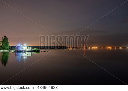 Evening Forest On The Lake Shore With Moored Yacht At The Edge Of The City. Beautiful Lake In The Ci
