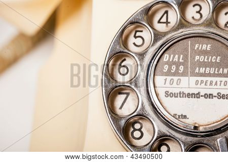 Fifties antique British GPO 332L ivory color bakelite telephone - macro shot of dial detail poster