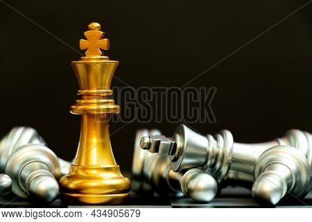 Gold King Chess Piece Win Over Lying Down Silver Team On Black Background