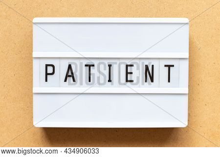 Lightbox With Word Patient On Wood Background