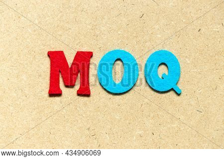 Color Cloth Alphabet Letter In Word Moq (abbreviation Of Minimum Order Quantity) On Wood Background