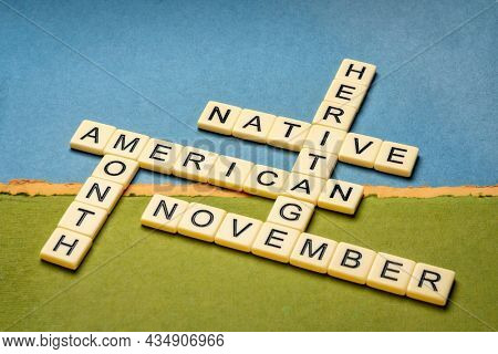 November - National Native American Heritage Month, crossword on abstract paper landscape, reminder of historical and cultural event