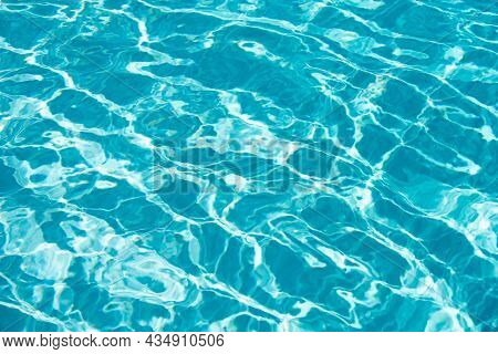 Abstract Ripple Wave And Clear Turquoise Water Surface In Swimming Pool, Blue Water Wave For Backgro