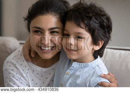 Loving Young Asian Indian Woman Cuddling Adorable Little Child Son.