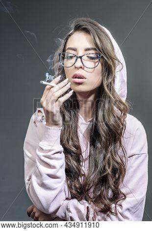 Smoking Girl. Cigarette Nicotine Addiction. Women With Smoke Addiction. Sensual Girl With Cigarettes
