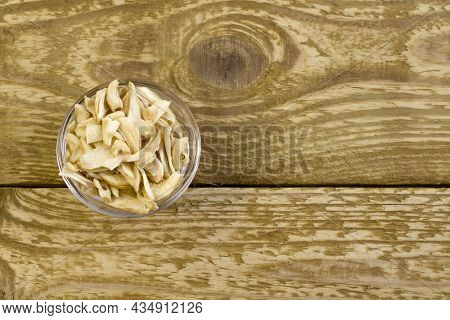 Dried Garlic Flakes On Glass Plate Close Up Flat Lay Photo On Grey Textured Wooden Background Top Vi