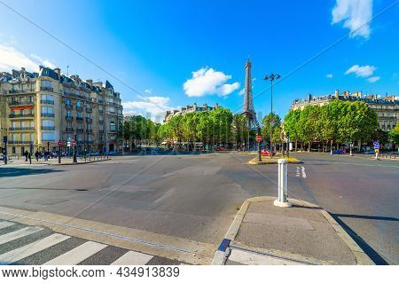 Paris Street With View On The Famous Eiffel Tower In Paris, France