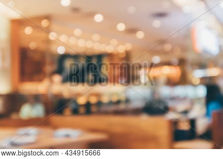 Cafe Restaurant Interior With Customer And Wood Table Blur Abstract Background With Bokeh Light