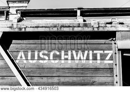 Auschwitz Written In White Big Letters On A Wooden Wagon Of An Old Original Freight Train On The Unl