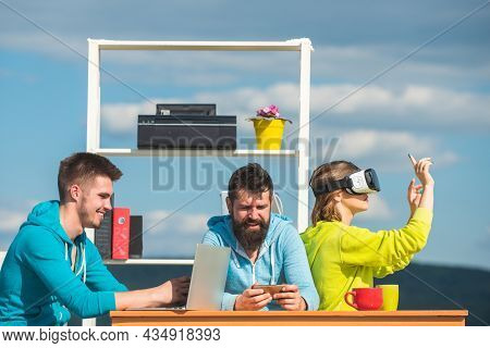 Business Team Using Virtual Reality Headset And Digital Gadgets Outdoors Office Meeting. Developers