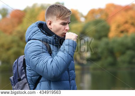 Sick Ill Young Man Drips, Injecting Nasal Drop For Blocked Nose In Park. Handsome Guy With Runny Nos