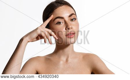 Skin Care And Women Beauty. Girl With Glowing Healthy Ski, Touching Her Face And Gazing At Camera, S