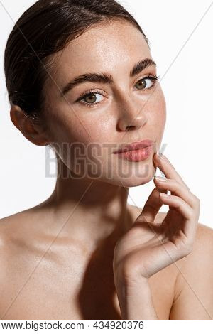 Beauty Face And Spa. Woman With Freckles, Clean Nourished Skin, Biting Lip And Look Aside. Girl Mode