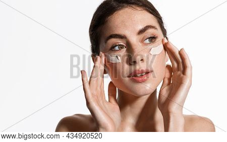 Beauty And Skin Care. Woman Applying Moisturizer, Facial Cream Or Clay Mask For Nourished, Glowing F