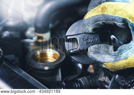 Mechanic Hand Open An Oil Filler Cap Of The Engine Car
