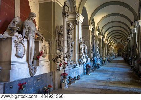 Genoa, Italy - June 2020: Corridor With Statues - Beginning 1800 - In A Christian Catholic Cemetery