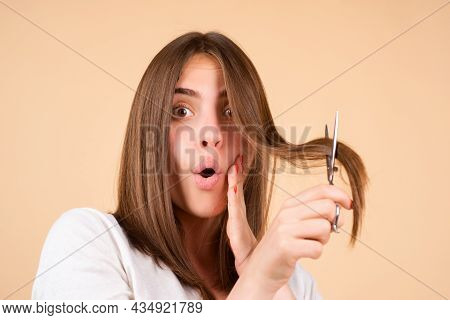 Excited Woman With Scissors Having Hair Cut. Amazed Girl With Straight Hair With Professional Scisso