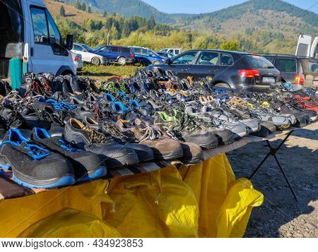 Palanca , Romania- 03 October 2021: Used, Labour Safety Shoes For Sale At Local Flea Market.