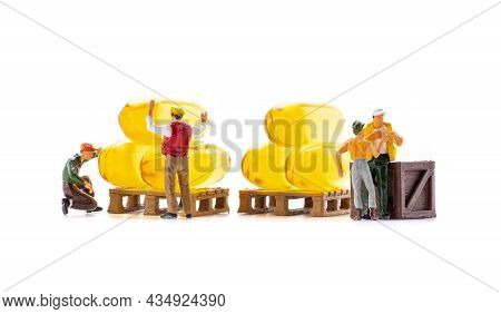 Miniature People Workers Transportation Fish Oil Supplement Capsules Isolated On White Background, H