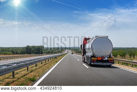 Fuel Truck On The Road. Truck Transporting Fuel On The Highway.
