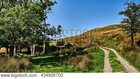 View Of A Ruined Farmstead With Trees At Bwlchstyllen On The Black Graded Syfydrin Mountain Biking T