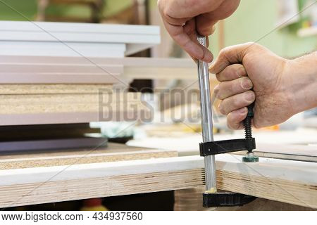 Bonding Wooden Parts From Plywood With Clamps In The Form Of Clamps. The Process Of Making Furniture