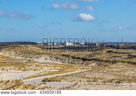 Dune Landscape With Hills, Marram Grass, Hiking Trails And The Reactor Center For The Production Of