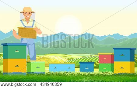 Beekeeper. Apiary In A Rural Landscape With Mountains. Character In Uniform And Mesh Protective Hat.