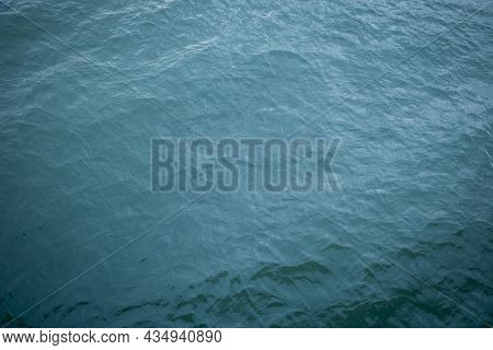 Aerial View Of Ripple Sea Waves. Turquoise Sea Texture With Waves. Water Sea Or Ocean For Background