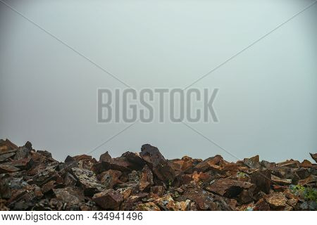 Empty Stone Desert Near Abyss Edge In Thick Fog. Zero Visibility In Mountains. Edge Of Abyss In Dens