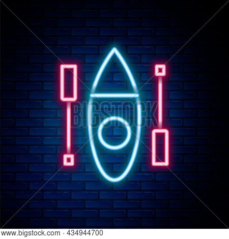 Glowing Neon Line Kayak And Paddle Icon Isolated On Brick Wall Background. Kayak And Canoe For Fishi