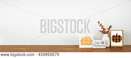 Happy Thanksgiving Decor On A Wood Shelf. Shabby Chic Wood Signs And Autumn Leaves Against A White W