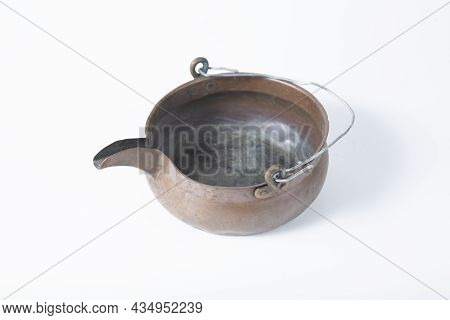 An Old Copper Washbasin On A White Background.old Things.
