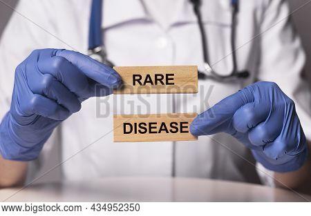 Rare Disease Words On Wood Blocks In Hands.