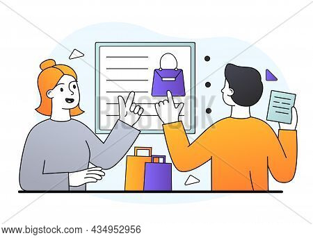Male Clothing Store Salesman Is Giving Information To New Buyer. Young Cheerful Female Buyer Is Goin