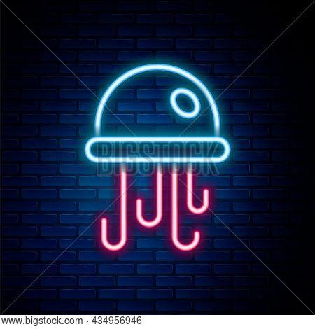 Glowing Neon Line Jellyfish Icon Isolated On Brick Wall Background. Colorful Outline Concept. Vector