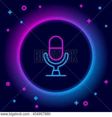 Glowing Neon Line Microphone Voice Device Icon Isolated On Black Background. Microphone Interpreter