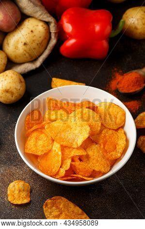 Paprika Potato Chips In White Bowl On Rustic Background