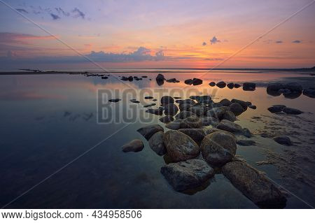 Summer Evening Sunset Landscape On The Shore Of The Gulf Of Finland Of The Baltic Sea With Stones.